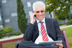 Business man working in park Royalty Free Stock Photography