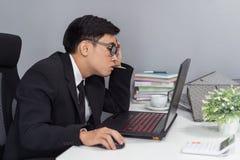 Business man working problem using laptop royalty free stock image