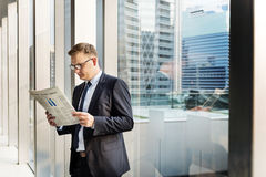 Business Man Working Reading Newspaper Concept Stock Photography