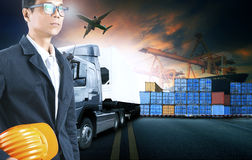 Business man working in shipping port use for logistic and cargo Stock Photo