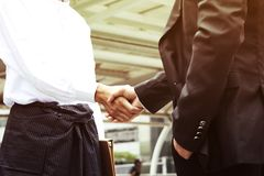 Business man working show hand shake success in the capita royalty free stock photography