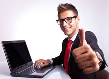 Business man working and showing ok Stock Photo