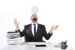 Business man working with soccer ball on his head in office Royalty Free Stock Images