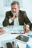 Business man working at table Royalty Free Stock Image