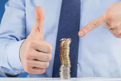 Business man working at the table and showing thumb up sign Stock Images