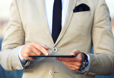 Business man working with a tablet. Business man working with a digital tablet Royalty Free Stock Photo