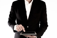 The business man is working on the tablet isolated on white background Stock Photo