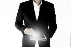 The business man is working on the tablet isolated on white background Stock Image