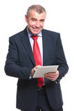 Business man working on a tablet Stock Photography