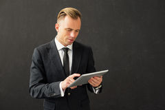 Business man working on tablet Stock Photo