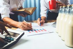 Business man working teamwork in milk bottle quality control har. D job concept, quantity checking in the office, Facility layout planning in the future Royalty Free Stock Photo