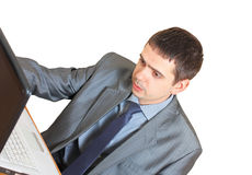 Business man in the workplace with a laptop Stock Images