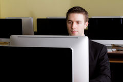 Business man at workplaces in computer Stock Photography