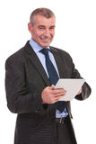 Business man works on tablet Royalty Free Stock Photos