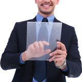 Business man works on transparent touch screen Stock Image