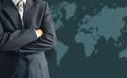 Business man and world map. Business man in front of world map Stock Image