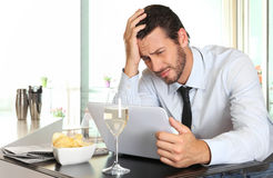 Business man worried by the bad financial news Stock Photo