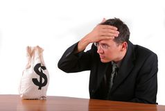 Business man worried about his money bag. Business man looking worried his money bag Royalty Free Stock Images