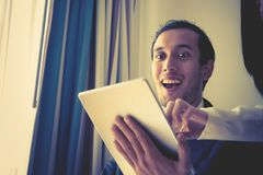 Business man wow with what on tablet. Business man is wow with what on tablet royalty free stock photo