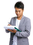 Business man writ on clipboard Stock Images
