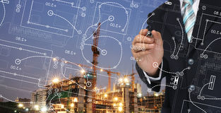Business Man write architect plan Stock Photo