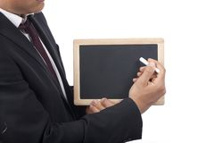 Business man write with chalk on black board Royalty Free Stock Images