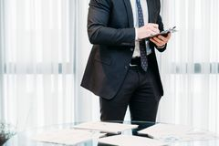 Business man write idea list planning paper. Company executive or manager man writing down ideas or to do list. business planning and organization. paperwork Royalty Free Stock Images