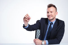 Business man writes on imaginary screen Stock Image