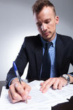 Business man writes something down Royalty Free Stock Photography