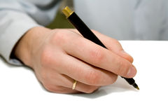 Business man writing. A businessman with pen in hand and ready to write Stock Image