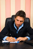 Business man writing Royalty Free Stock Image