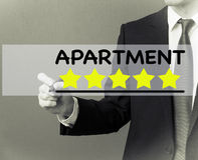 Business man writing - Apartment rating stars.  stock image