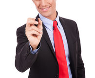 Business man writing with black marker Royalty Free Stock Images