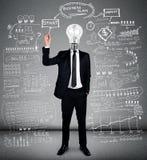 Business man writing business plan Stock Photography