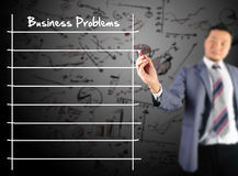 Business man writing Business problem. With diagram and chart background Stock Photography