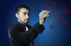 Business man writing chart of pursue debts Stock Photography