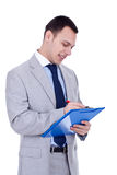 Business man writing on clipboard Royalty Free Stock Image