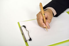 Business Man Writing On Clipboard Stock Images