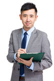 Business man writing on clipboard Royalty Free Stock Photos
