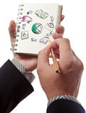 Business man writing collaboration diagram. On book Stock Photography