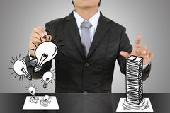 Business man writing concept of Paper light bulb and money. Business man writing concept of Paper light bulb Royalty Free Stock Image