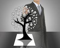 Business man writing concept of Paper light bulb tree Royalty Free Stock Images