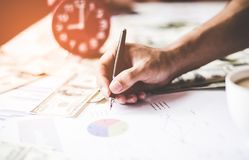 Business man  writing documents graph, report finance. Business Concept. select focus Royalty Free Stock Photography