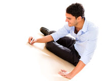 Business man writing on the floor Stock Photo