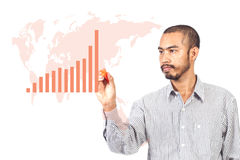 Business man writing graph with worldmap Stock Images
