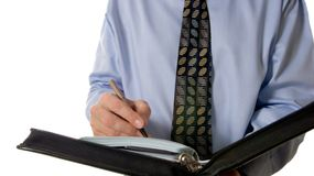 Business Man Writing In Leather Organizer Stock Photography