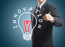 Business man writing innovation concept. On screen Stock Image