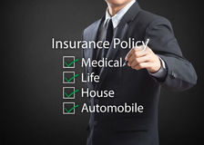 Business man writing insurance policy. Business man writing life insurance policy Royalty Free Stock Photos