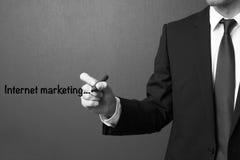 Business man writing internet marketing Royalty Free Stock Image