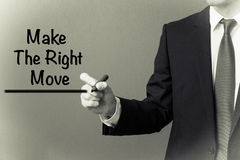 Business man writing - Make the Right Move.  Stock Images
